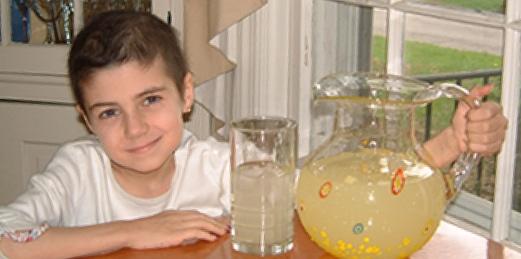 Alex Scott from Alex's Lemonade Stand Foundation holding a pitcher of lemonade